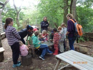 Families coming together to have fun and learn in the woodland